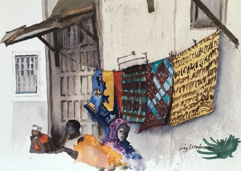 East Africa.  Doorstep washing, Stone Town.